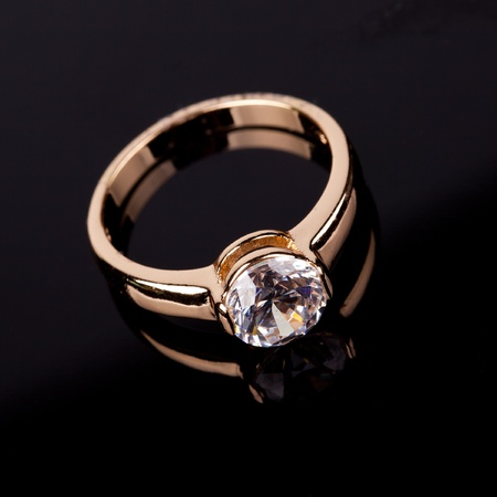 wedding ring with stone on black backrground photo