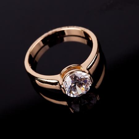 wedding ring with stone on black backrground photo