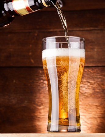 glass of fresh golden beer photo
