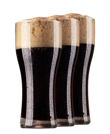Frosty glasses of dark beer isolated on a white background photo