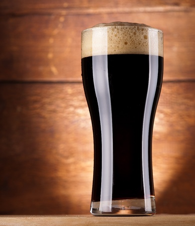 glass of fresh dark beer