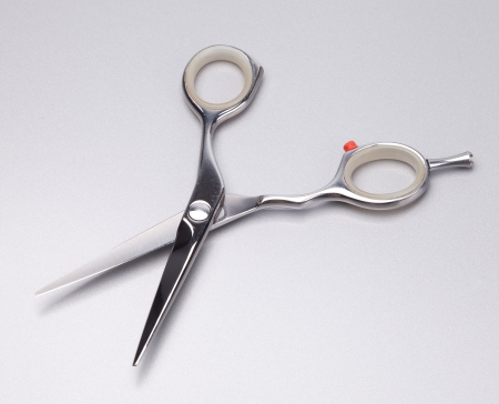 metal scissors on grey background photo