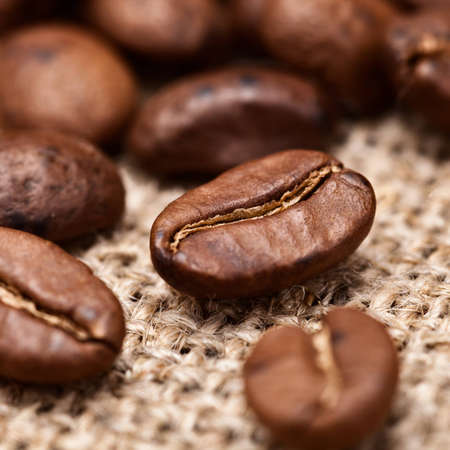 Coffee Beans on hessian background Stock Photo - 12604353