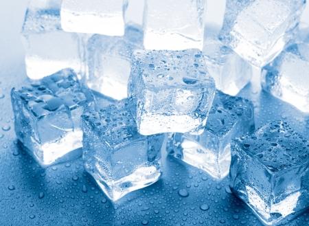 melting ice cubes on glass table Stok Fotoğraf - 14038644