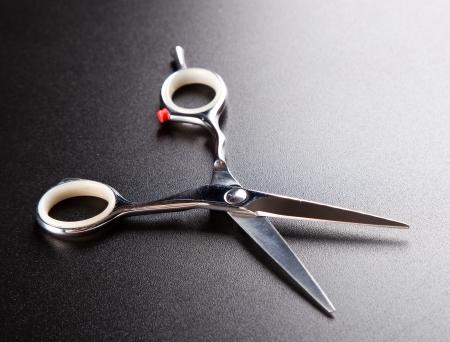 professional hairdresser scissors on  dark background photo