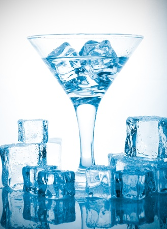 melting ice cubes and glass of alcohol Stock Photo - 14106906