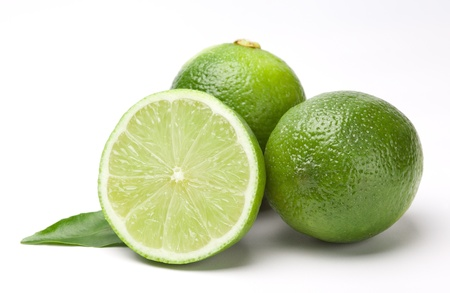 limes with leaf isolated on white Stock Photo - 14106881