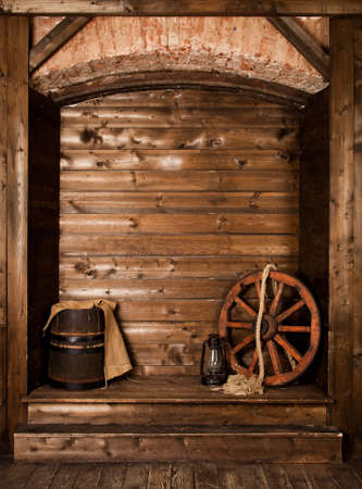 wooden background with wheel and barrel photo