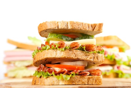 big sandwich with fresh vegetables on wooden board Stock Photo - 17416520