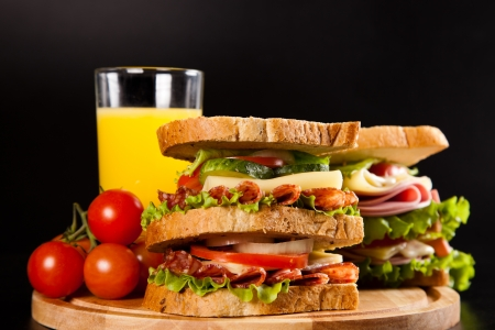 big sandwich with fresh vegetables on black background Stock Photo - 17416526
