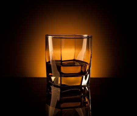 whiskey in glass with reflection photo