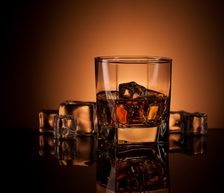 whiskey in glass with reflection