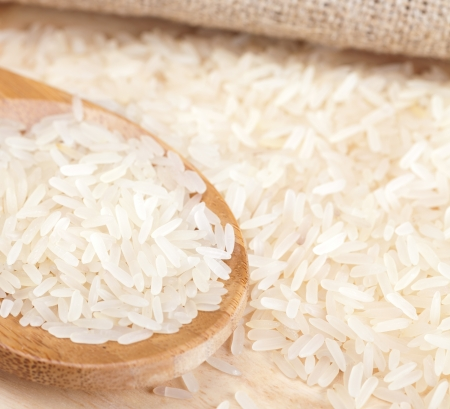 wooden spoon with raw rice photo