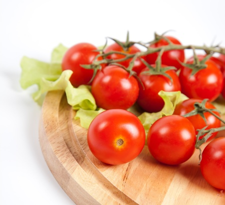 fresh tomatoes on wooden board photo