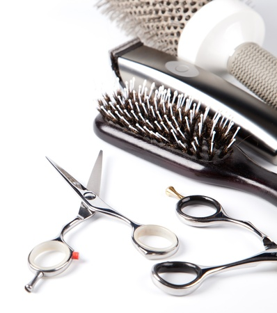 cutting hair: scissors and combs on white Stock Photo