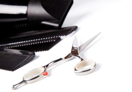 haitdresser scissors,  combs and brush on white background Stock Photo - 21074616