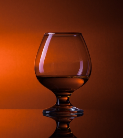 cognac in fancy glass, with reflection photo