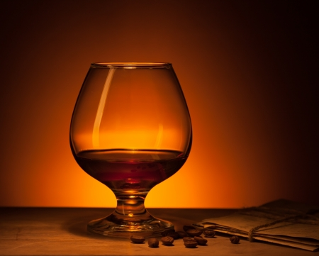 Glass of cognac with old love letters photo