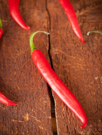 red peppers on wooden background photo