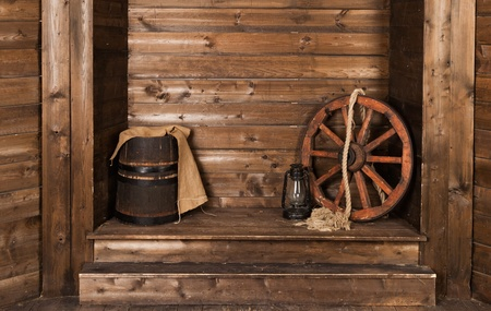 wheel barrel: wooden background with wheel and barrel