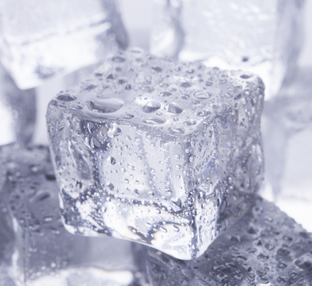 melting ice cubes on glass table
