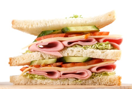 big sandwich with fresh vegetables on wooden board on white  photo