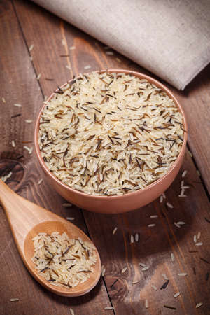 wild rice in brown bowl photo