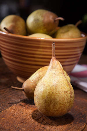ripe pears on wooden table photo
