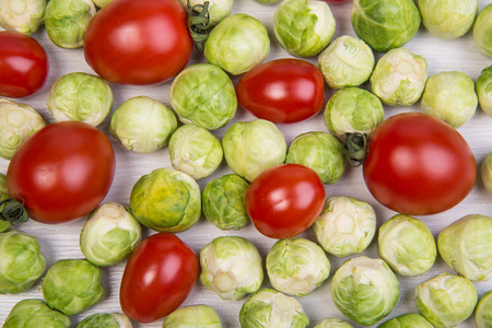 brussel: ripe tomato and fresh green brussel sprouts