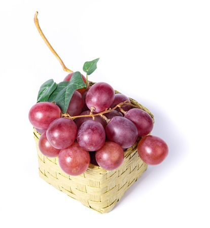 willow fruit basket: red grapes on white