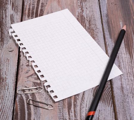 diagonal diary education: black pencil and sheet