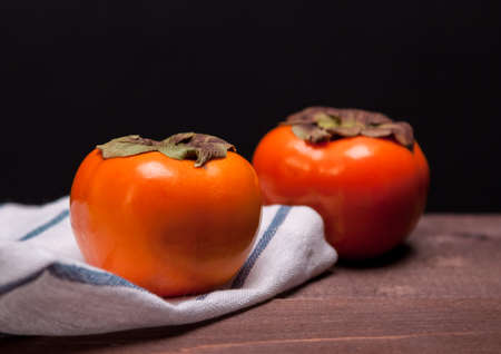 persimmons: two persimmons
