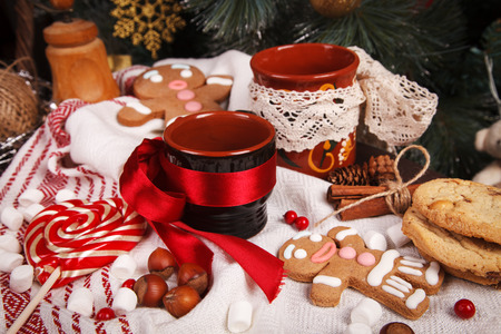 cups on holiday decorations photo