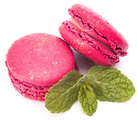 sprig: two pink macaroons with sprig of mint isolated