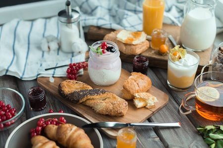 orenge: the cream mousse with the red currant and the mousse with physalis in the little glasses, milk or orange juice or hot tea at a choice