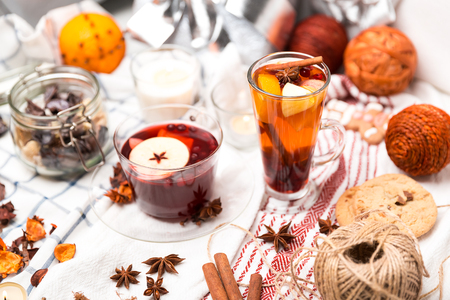 cup of hot mulled wine and a delicious cup of grog among the many delicious detail  on white checkered tablecloth