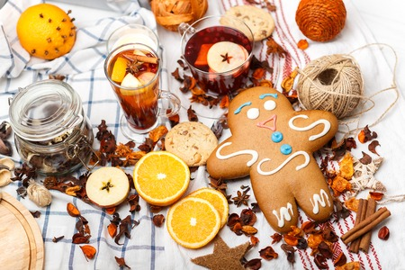 giant gingerbread among pieces of fruits and spices