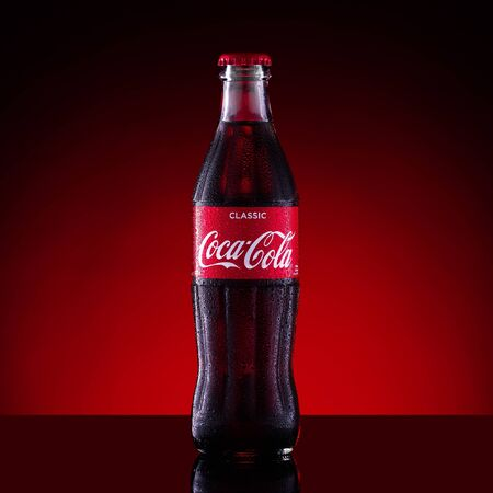 Saint-Petersburg, Russia, april 22 2019. Photo of cold glass bottle of coca cola. Editorial use only. Editöryel