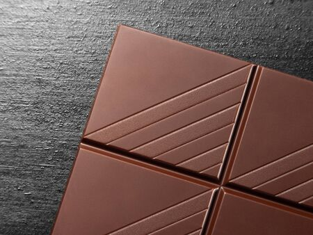 Close up of a chocolate bar on black rustic