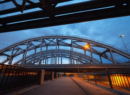 The American railway bridges on the Obvodny Channal in the evening. Industrial architecture in city center. St. Petersburg, Russia