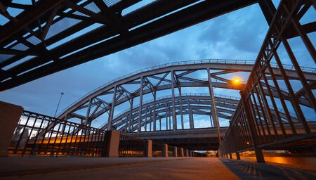 The American railway bridges on the Obvodny Channal in the evening. Industrial architecture in city center. St. Petersburg, Russia Stok Fotoğraf