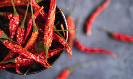 Top view of spicy red hot chili peppers placed in bowl on table Stok Fotoğraf