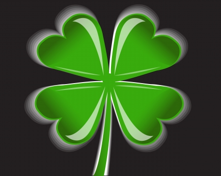 shiny four-leaf clover on a black background