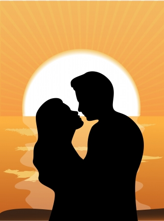 Silhouettes of people loving couple at sunset