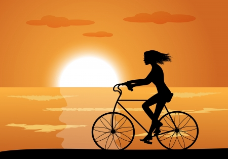 back lit: silhouette of a girl on a bike ride on the background of the sea and the sunset
