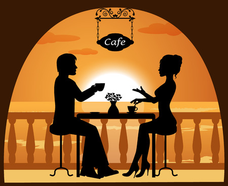 woman drinking tea:   heterosexual couple in a cafe on the beach at sunset