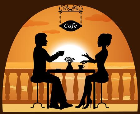 heterosexual: pareja heterosexual en un caf� en la playa al atardecer