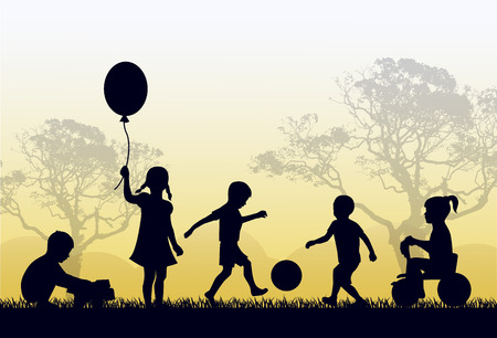 soccer game: Silhouettes of children playing outside in the grass and trees