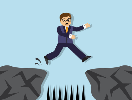 ravine: Businessman jumps from one cliff to another. Between the cliffs sharp stakes.