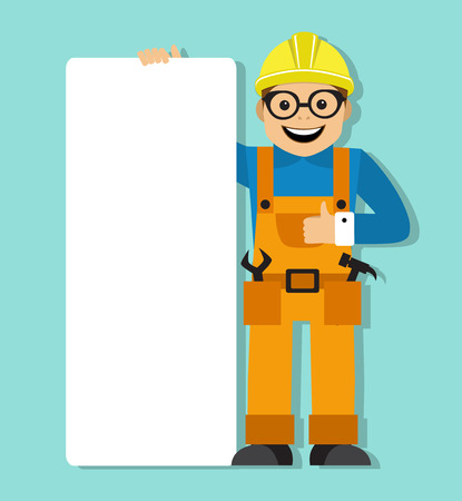 construction helmet: worker in helmet holding a blank poster. Work is dressed in overalls and his tools in his pockets.
